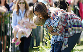 United Stsates first lady Michelle Obama greets kids after reading a the story My Garden during the annual White House Easter Egg Roll on the South Lawn of the White House April 21, 2014 in Washington, DC. President Barack Obama and first lady Michelle Obama hosted thousands of people during the annual celebration of Easter. <br /> Credit: Olivier Douliery / Pool via CNP