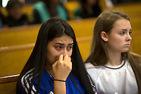 BURLINGTON, WA - SEPTEMBER 24: Selena Orozco,15 and Rachel March, 15, pray during a vigil held at the Central United Methodist Church on September 24, 2016 in Sedro-Woolley, Washington. The vigil was held in response to the shooting deaths of five people in the Cascade Mall last night. Oorzco and March knew one of the victims. (Photo by Karen Ducey/Getty Images)