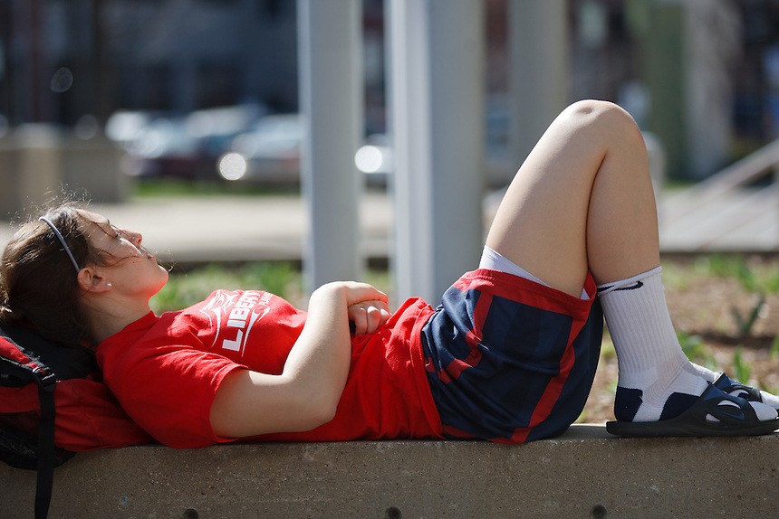 Ellie Rollins relaxes while waiting for the bus