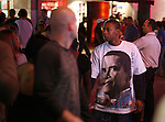 A black man wears a T Shirt of Presidential candidate Barack Obama on Bourbon Street New Orleans Louisiana Saturday Oct 25 2008. Americans will go to the polls on Nov 4, at a time of great Financial crisis, war in Iraq and Afghanistan, to elect a  new President. A vote, that will affect not only America, but the whole world. Photo by Eyal Warshavsky .