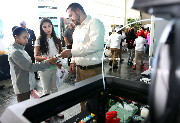 WATERBURY CT. 15 November 2016-111816SV02-From left, Makayla Aviles, 13, and Tatiana Wright, 12, both of Waterbury check out printed items from a 3d printer with Jeff Burchard of AET Labs during the Waterbury Regional Chamber's 2016 STEM/Advanced Manufacturing &amp; Technology Expo at Naugatuck Valley Community College in Waterbury Friday.<br /> Steven Valenti Republican-American