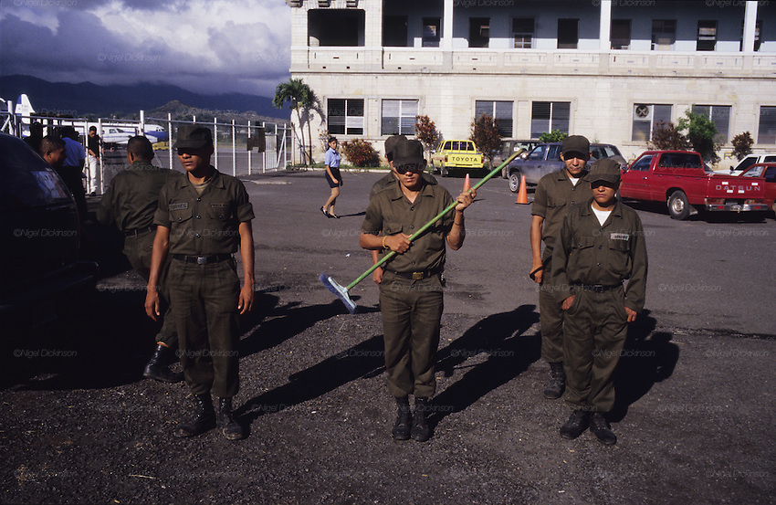Central America, Honduras, Tegucigalpa. Devastation in the aftermath of Hurricane Mitch. High winds and flooding.  Reconstruction of capital. Army conscripts with broom.