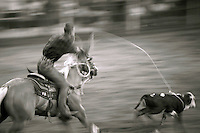 Annual rodeo in a small town near Houston, contestant in calf roping event. Cypress Texas USA.