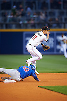 Nashville Sounds shortstop Chad Pinder (11) turns a double play as Willson Contreras (40) slides in during a game against the Iowa Cubs on May 3, 2016 at First Tennessee Park in Nashville, Tennessee.  Iowa defeated Nashville 2-1.  (Mike Janes/Four Seam Images)