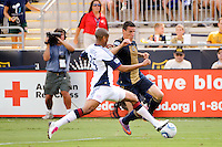 Sebastien Le Toux (9) of the Philadelphia Union is marked by Darrius Barnes (25) of the New England Revolution. The Philadelphia Union and the New England Revolution  played to a 1-1 tie during a Major League Soccer (MLS) match at PPL Park in Chester, PA, on July 31, 2010.