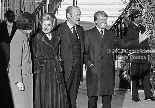 """United States President Gerald R. Ford, right center, and first lady Betty Ford, left center, welcome US President-elect Jimmy Carter, right, and Rosalynn Carter, right, to the White House in Washington, D.C. on November 22, 1976.  This is the first meeting between the two men since the Presidential debates during the campaign.<br /> Credit: Benjamin E. """"Gene"""" Forte / CNP"""