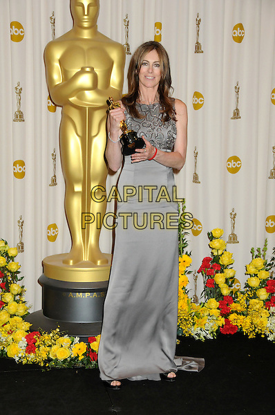KATHRYN BIGELOW  .82nd Annual Academy Awards held at the Kodak Theatre, Hollywood, California, USA..March 7th, 2010.oscars full length maxi silver grey gray dress sleeveless winner trophy.CAP/ADM/BP.©Byron Purvis/AdMedia/Capital Pictures.