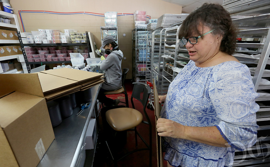 NWA Democrat-Gazette/DAVID GOTTSCHALK Carolyn Reed, packaging, assembles boxes Wednesday, July 3, 2019, at the Kyya Chocolate Factory and Tasting Room in Elm Springs. Kyya was the first bean to bar chocolate comparing in Arkansas and the name comes from the Greek, KAIA, which means pure, simple, or straight forward.