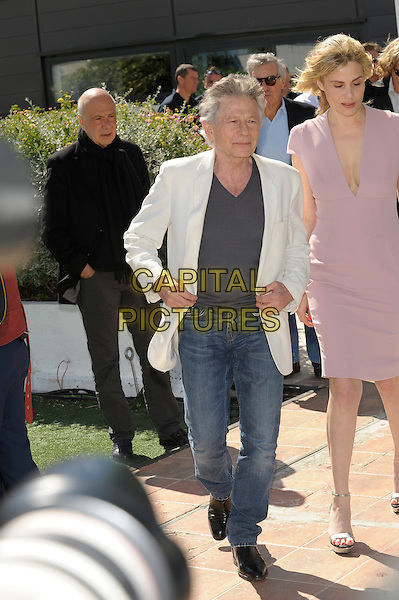 Roman Polanski, Emmanuelle Seigner.'La Venus A La Fourrure'  photocall at the 66th Cannes Film Festival, France 23rd May 2013.full length white suit jacket grey gray top jeans denim pink dress.CAP/PL.©Phil Loftus/Capital Pictures.