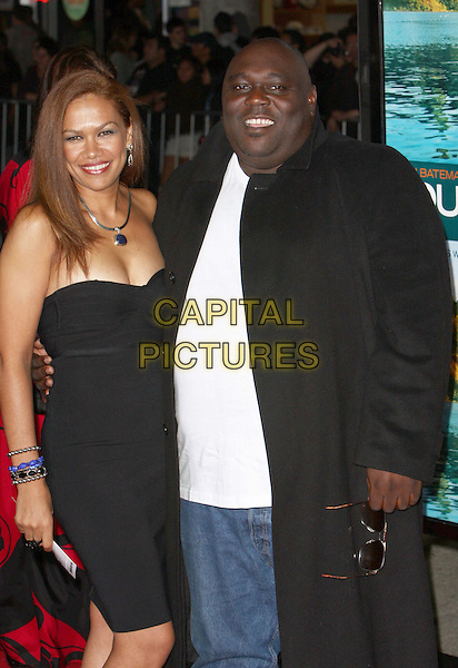 "GUEST & FAIZON LOVE.""Couples Retreat"" Los Angeles Premiere held at Mann Village Theatre, Westwood, CA, USA..October 5th, 2009.half length black strapless dress trenchcoat trench coat white top.CAP/ADM/CH.©Charles Harris/AdMedia/Capital Pictures"