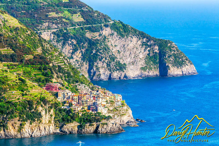 Hanging on the side of a Cinque Terre cliff here is the fishing village of Manarola Italy.
