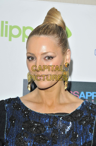 Tess Daly.Drapers Fashion Awards 2011, Grosvenor House hotel, Park Lane, London, England, Wed/16th/Nov/2011..November 16th, 2011.headshot portrait dangling gold earrings black blue sequins sequined  hair up bun.CAP/CAN.©Can Nguyen/Capital Pictures.