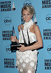 Carrie Underwood at the 2007 American Music Awards press room held at the Nokia Theatre Los  Angeles, Ca. November 18, 2007.  Fitzroy Barrett