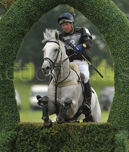 01.09.2012 Burghley House Stamford, England. Dag Albert (SWE) riding TUBBER REBEL in action at the Fifty-Fifty Island during the cross country phase on day three of The Land Rover Burghley Horse Trials.