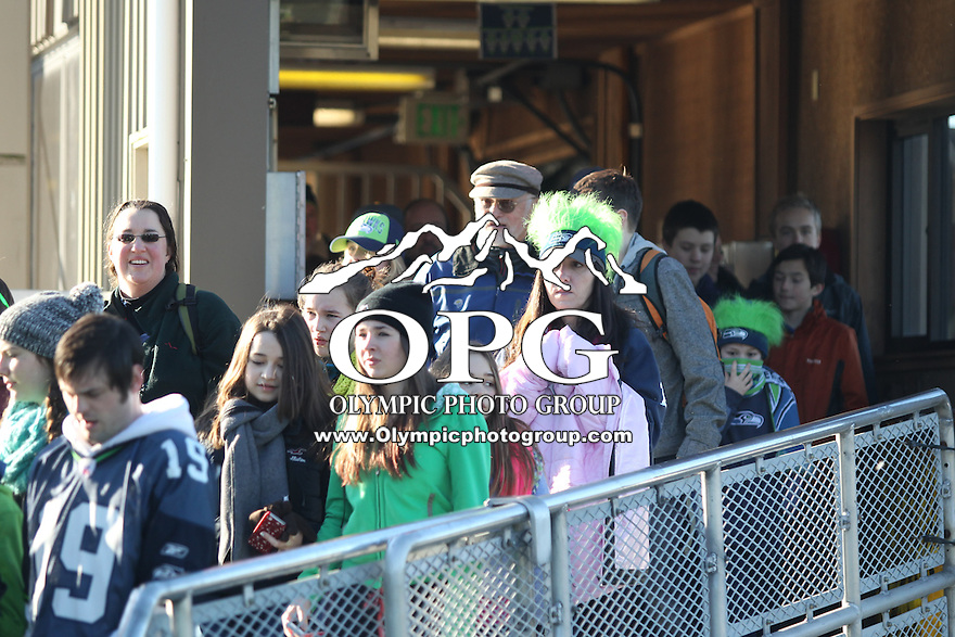 2014-02-05:  Over 19,000 Seattle Seahawks fans waited in long lines to catch the Bainbridge Island Ferry to Seattle. Seattle Seahawks players and 12th man fans celebrated bringing the Lombardi trophy home to Seattle during the Super Bowl Parade at Century Link Field in Seattle, WA.