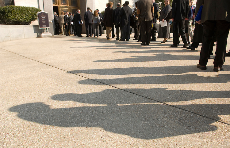 People wait in line to get into the Dirksen Senate Office Buidling on Tuesday, March 11, 2008.