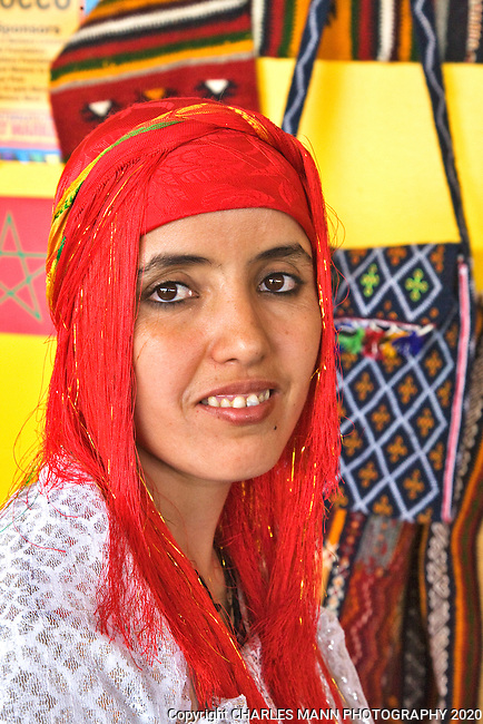 The Santa Fe International Folk Art Market attracts a huge crowd of shoppers and features a wide variety of folk artists from all over the world. Artist Rkia Ait El Hasan ois from Morocco.