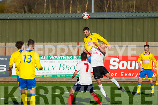 Killorglins Lee Carey out jumps John O'Connor of CSKA Tralee in the KDL league game in Mounthawk Park, Tralee on Sunday last.