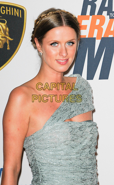 NICKY HILTON .Arriving at The 17th Annual Race to Erase MS at the Hyatt Regency Century Plaza Hotel in Century City, California, USA, May 7th, 2010..half length green grey gray silver knitted one shoulder dress cut out braid plait hair up make-up eyeliner plaited braided .CAP/ROT.©Lee Roth/Capital Pictures