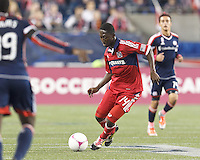 Chicago Fire midfielder Patrick Nyarko (14) at midfield. In a Major League Soccer (MLS) match, the New England Revolution (blue) defeated Chicago Fire (red), 1-0, at Gillette Stadium on October 20, 2012.