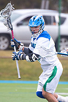 Jake Gonzalez,'17, takes control during the Men's Lacrosse game action at Gaudet Field in Middletown.