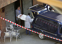 Orio, Basque Country. 21st March 2002. Funeral services collect the corpse of the Socialist mayor of Orio (Basque Country) Juan Priede, committed by ETA on March 21, 2002 at the bar where Priede used to drink coffee..Photo, Ander Gillenea