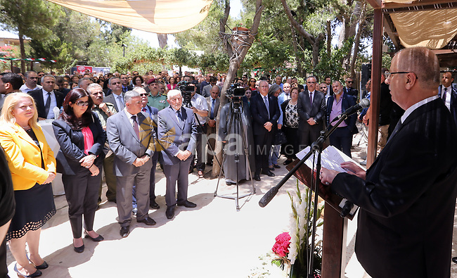 """Palestinian Prime Minister Rami Hamdallah receives """"The Order of the Star of Italy"""" from the Italian Consul General Fabio Sokolovic, in the West Bank city of Ramallah on June 21, 2018. Photo by Prime Minister Office"""