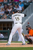 Trayce Thompson (15) of the Charlotte Knights at bat against the Norfolk Tides at BB&T BallPark on April 9, 2015 in Charlotte, North Carolina.  The Knights defeated the Tides 6-3.   (Brian Westerholt/Four Seam Images)