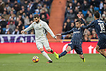 José Ignacio Fernández Iglesias, Nacho (l), of Real Madrid battles for the ball with Michael Santos of Malaga CF during their La Liga 2016-17 match between Real Madrid and Malaga CF at the Estadio Santiago Bernabéu on 21 January 2017 in Madrid, Spain. Photo by Diego Gonzalez Souto / Power Sport Images