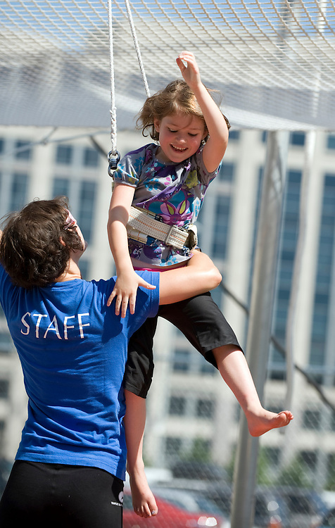Instructor Mandy Keithan catches Isobel Ehrman, 6, of Boise, Idaho, after she performed a trick at Trapeze School New York at 9th and H, NW, July 15, 2009.
