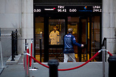 New York, New York<br /> March 18, 2020<br /> 9:16 AM<br /> <br /> Manhattan under coronavirus pandemic. <br /> <br /> New York Stock Exchange on Wall Street as traders enter the building to be met by medical workers checking people in fear of spreading the virus.