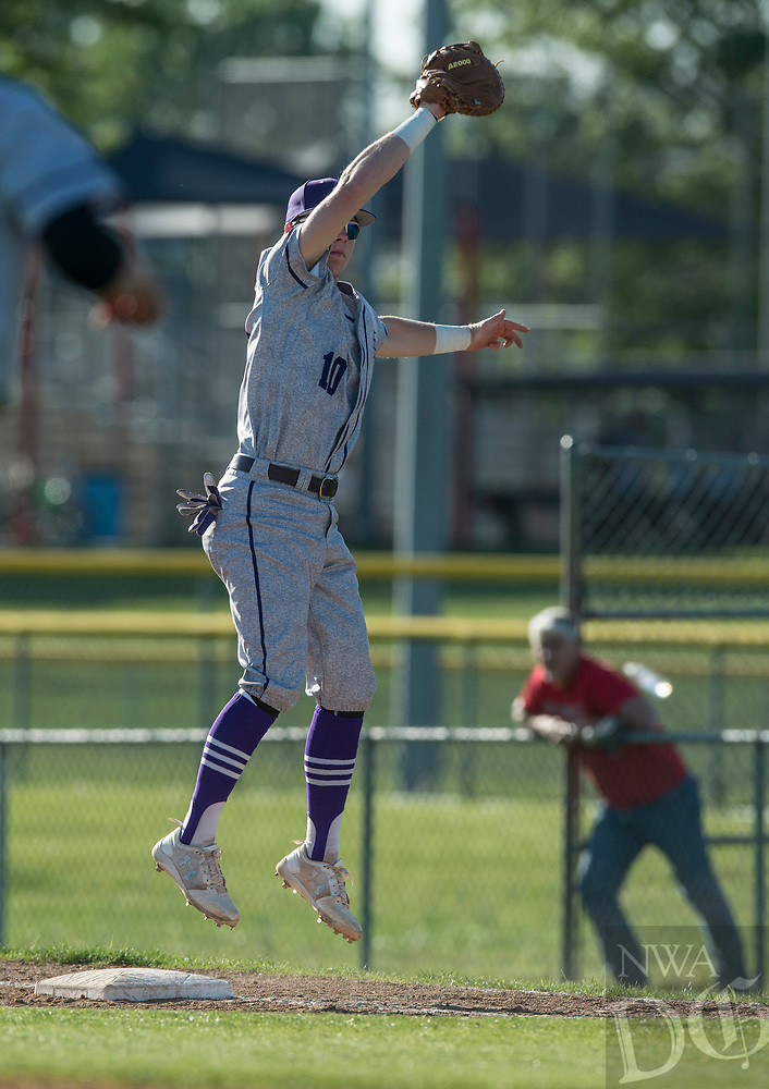 NWA Democrat-Gazette/ANTHONY REYES @NWATONYR<br /> Barrett Banister (10) of Fayetteville leaps for the ball for an out against Springdale Monday, April 24, 2017 at Bob Lyall Field in Springdale. The Purple Dogs won 3-2.