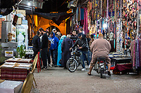 Marrakesh, Morocco.  Zeitoun El-Kedim Street, Pedestrian and Vehicular Traffic.