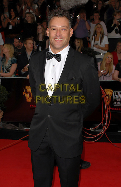 TOBY ANSTIS.Arrivals at the Pioneer British Academy Television Awards 2006 at the Grosvenor House Hotel, London, UK..May 7th, 2006 .Ref: CAN.BAFTA TV.half length black tuxedo.www.capitalpictures.com.sales@capitalpictures.com.©Capital Pictures