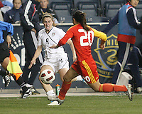 Heather O'Reilly #9 of the USA WNT moves towards Gaoping Zhou #20 of the PRC WNT during an international friendly match at PPL Park, on October 6 2010 in Chester, PA. The game ended in a 1-1 tie.