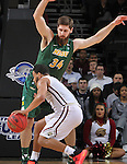 SIOUX FALLS, SD - MARCH 6:  Jordan Pickett #4 of IUPUI plows into Noah Thomas #35 of North Dakota State head first in the 2016 Summit League Tournament. (Photo by Dick Carlson/Inertia)