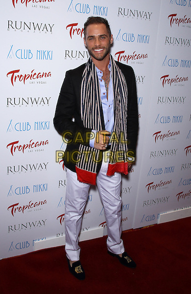 Josh Strickland.Runway Magazine launches its Summer 2011 issue featuring Holly Madison at Club Nikki Las Vegas at The Tropicana Las Vegas, Las Vegas, Nevada, USA, 22nd June 2011..full length striped scarf  white trousers red  shirt blue .CAP/ADM/MJT.© MJT/AdMedia/Capital Pictures.