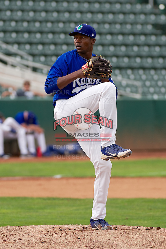 Ogden Raptors starting pitcher Luis De Paula (13) delivers a pitch to the plate against the Grand Junction Rockies at Lindquist Field on September 8, 2013 in Ogden Utah.  (Stephen Smith/Four Seam Images)
