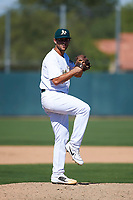 Oakland Athletics pitcher Logan Salow (65) delivers a pitch to the plate during an Instructional League game against the Cincinnati Reds on September 29, 2017 at Lew Wolff Training Complex in Mesa, Arizona. (Zachary Lucy/Four Seam Images)