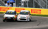 Two Nissan Micras battle it out at the hairpin corner of the Circuit Gillles-Villeneuve during the Grand Prix of Canada on the 7th of June at Circuit Gilles-Villeneuve