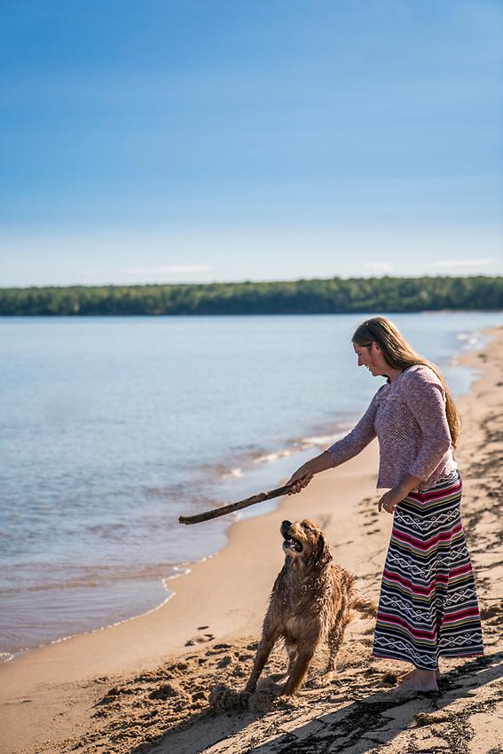 Lake Superior summer beach day with golden retriever dog on Michigan's Upper Peninsula.