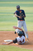 Shortstop Oscar Tejeda (5) of the Greenville Drive turns a double play as Mark Fleisher (34) of the Kannapolis Intimidators slides into second base at Fieldcrest Cannon Stadium in Kannapolis, NC, Sunday August 10, 2008. (Photo by Brian Westerholt / Four Seam Images)