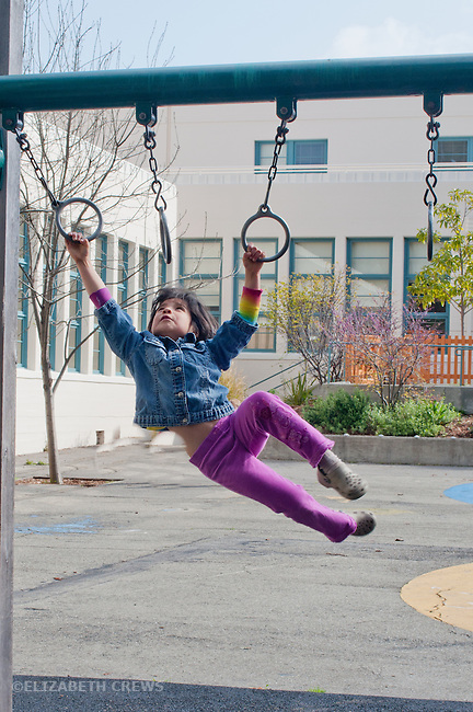 Berkeley CA Kindergarten student, Guatemalan, energetically playing with rings during school recess