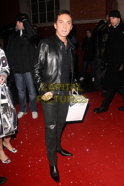 BRUNO TONIOLI.Cecile & Hermione English National Ballet's Christmas VIP Party at St Martins Hotel, London, England..December 16th 2009 .full length black leather jacket trousers jeans goody bag.CAP/AH.©Adam Houghton/Capital Pictures.