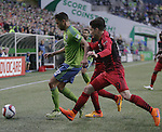 Seattle Sounders Lamar Neagle (27) battle for the ball against  Portland Timbers Diego Chara (21) and Joge Villafana (19) during an MLS match on April 26, 2015 at CenturyLink Field in Seattle, Washington.  Seattle Sounders Clint Dempsey scored a goal to give the Sounders a 1-0 victory over the Timbers. Jim Bryant Photo. ©2015. All Rights Reserved.