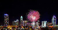Fireworks from Skyshow Charlotte  2015 explode over the Charlotte NC skyline as the city celebrated the July 4th holiday in 2015. Photographer has fireworks celebrations in Charlotte from multiple years. The collection of Charlotte NC fireworks photos show different perspectives and weather conditions.<br /> <br /> Charlotte Photographer - PatrickSchneiderPhoto.com