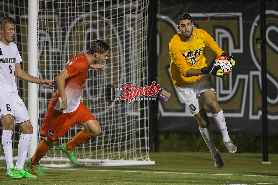 Alec Ferrell (0) of the Wake Forest Demon Deacons makes a save during first half action against the Clemson Tigers at Spry Soccer Stadium on September 26, 2015 in Winston-Salem, North Carolina.  The Demon Deacons and the Tigers played to a 1-1 draw.  (Brian Westerholt/Sports On Film)