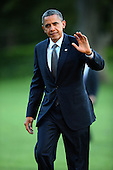 United States President Barack Obama waves to members of the news media after arriving at the White House September 13, 2012 in Washington, DC. Obama returned to Washington after a two-day campaign trip to Nevada and Colorado. .Credit: Chip Somodevilla / Pool via CNP
