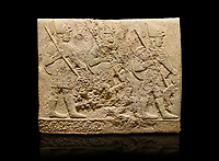 Hittite sculpted orthostats of Long Wall Limestone, Karkamıs, (Kargamıs), Carchemish (Karkemish), 900-700 BC. Anatolian Civilisations Museum, Ankara, Turkey<br /> <br /> Soldiers. Figure of three helmeted warriors. They have their shield in their back and their spear in their hand. The prisoners in their front are depicted as small. The lower part of the orthostat is decorated with wring / braiding motifs.<br /> <br /> On a black background.