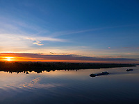 Sunrise view from a Bridge in Phnom Penh, Cambodia Sunrise and the Bassac River this river is a  distributary of the Tonlé Sap and Mekong River River from a Bridge in Phnom Penh, Cambodia boats, sky, moody, colourful, colorful,